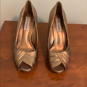 Matted gold heels.